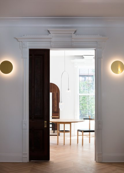 Modern lighting, including Ross Gardam's Polar wall lamp, provides contrast with the historic architecture.