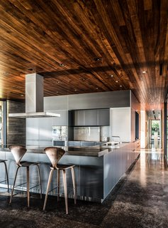 The stainless-steel kitchen system is by Bulthaup, and the countertop was fashioned by Brooklyn–based Wüd Furniture Design.