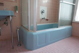 The architects preserved the blue enamel tub and original tin ceilings.