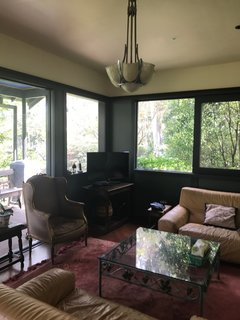 More dark paint distracted from the views outside, and the new homeowners wanted to embrace the garden setting of the home.