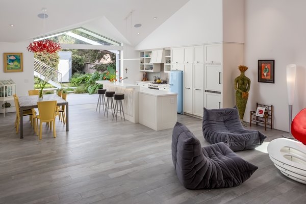 The Porcelain Plank Flooring Is Continuous Throughout With Zero Step Thresholds At Doors And Living Area