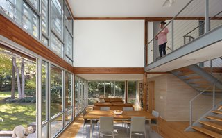 The exposed Douglas fir timber framework supports the addition.