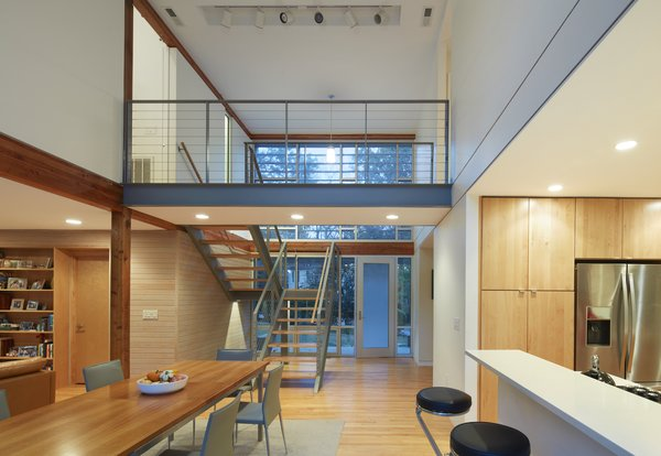 A steel bridge connects the upper level master suite (to the left) with the existing bedrooms to the right.