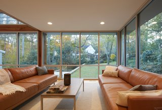 Views of the newly landscaped garden can be appreciated from two walls of glass in the living room.