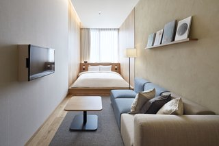 The hotel offers nine types of rooms. Many feature an elongated footprint with a window at one end.