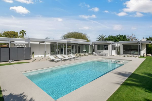 The L-shaped, flat-roofed Steel & Glass home has many of the hallmarks of Wexler's style. The 2,550-square-foot layout wraps a pool, made accessible by lots of sliding glass.