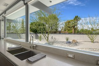 The kitchen overlooks the drought-tolerant landscaping in the yard.