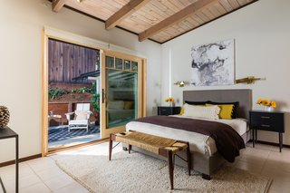 The wood ceilings continue throughout the house. The master suite has a private patio.