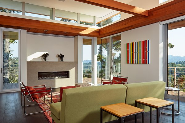 """""""Floor-to-ceiling glazing provides strong indoor/outdoor connections while carefully placed clerestory windows serve to infuse the home with dappled light from above, affording views of sky and treetops,"""" says the firm."""