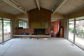 Before: An outdated fireplace dominated the semi-open plan and divided the living and dining rooms.