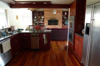 Before: Dark cabinetry and low ceilings made the kitchen feel cramped.