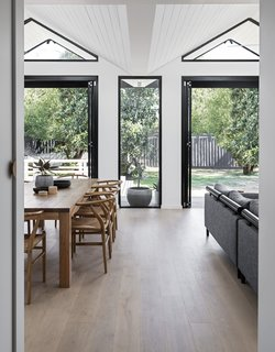 The firm lightly reorganized the front of the house to accommodate a master suite, a new bathroom, and two bedrooms, then grouped the living areas in the addition. The entry was aligned with the new rear extension, so that the backyard can be glimpsed from the front door.