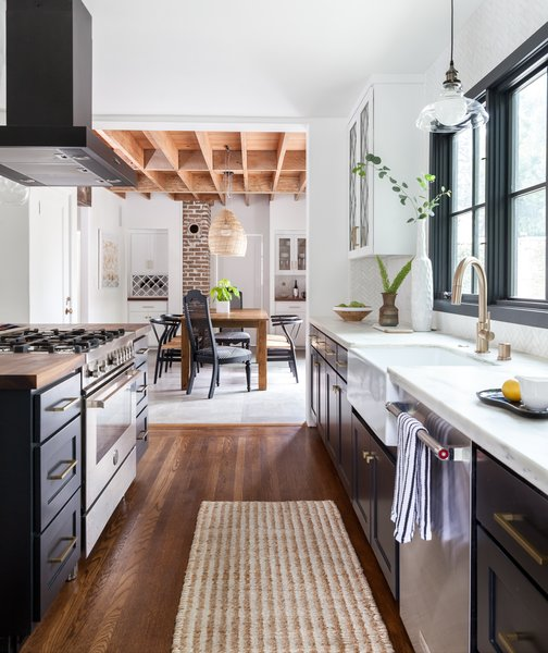 By reconfiguring the spaces, the couple were able to add more windows and bring in more natural light. Two original elements of the house were left as is in a nod to its history: the dining room's exposed Douglas fir ceiling and the brick chimney uncovered during the construction.