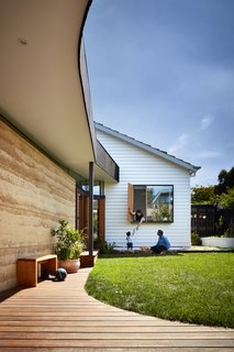 """""""The addition is oriented towards the sun and faces the original Californian bungalow, allowing you to look at the heritage house from the new part and vice versa,"""" said Welsch. """"It combines two unlikely architectural expressions—the casualness and generosity of a lightweight timber-clad building with the heaviness of earth construction."""""""