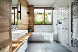 Signorino wall tiles in opal white meet Lapege's Colombino RB36 porcelain floor tiles.