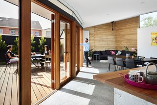 A curved wall of glass opens the shared living spaces to the communal courtyard.