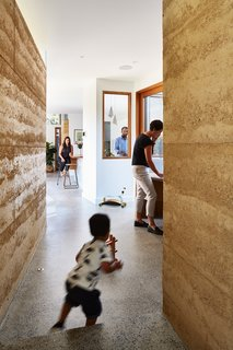 """An interior window allows occupants in the kitchen to see into the study and down the hall.<br>""""Our project reflects my idea of a home: Spaces as a background driver for family activities—functional, interconnected, and well-proportioned,"""" said Welsch."""
