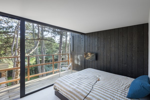 The Charred Wood Siding Carries Into Home S Single Bedroom Blurring Boundary Between Inside