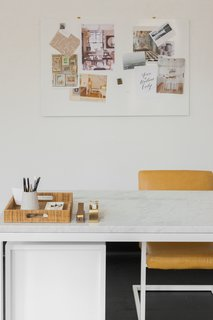 The workstations are outfitted with chic pieces from Room & Board, including the Lira Leather Dining Chair, Pratt Modern Desk, and Nolo Table Lamp.