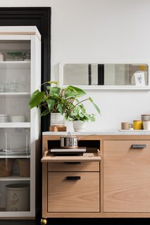 "The kitchen unit combines an oak base with a marble counter, and was custom made by local furniture maker Walnut x Oak. ""While we worked with Room & Board and Article to furnish the majority of the space, it was also important to us to use local vendors and artists in decorating,"" says LaValle."