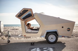 Gull-wing doors flank a three-quarter-size mattress that sleeps two adults.