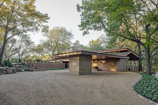 After: A commanding carport greets visitors at the entry point to the house.