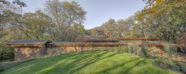 """The south view of the home shows how """"Wright characteristically located the house to be slightly below the highest point of the hill,"""" says the firm, which has renovated many Wright residences."""