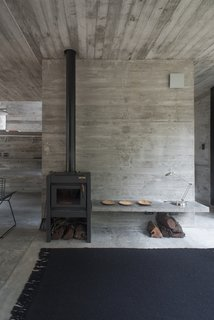 The uninterrupted use of concrete throughout the interior creates a sense of fluidity between spaces.
