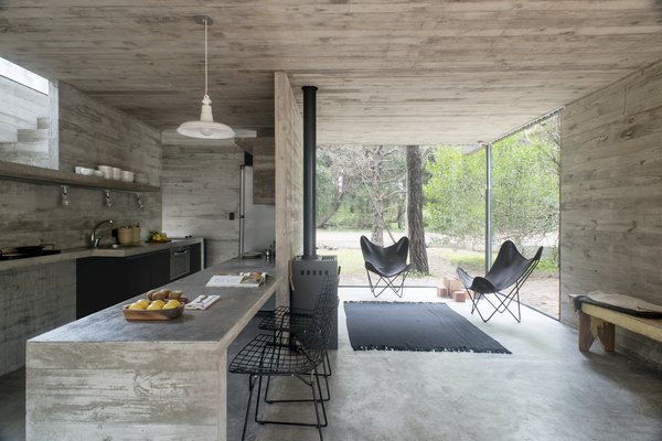 Inside, concrete is used as both a finish and a building material for integrated furnishings.