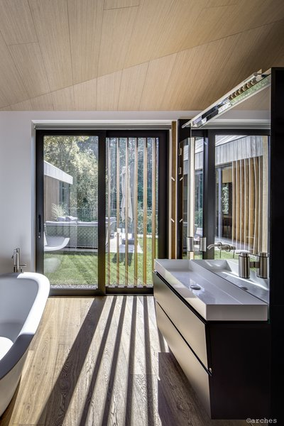 The wooden screens produce interesting shadows inside a bathroom and allow privacy from the adjacent terrace.