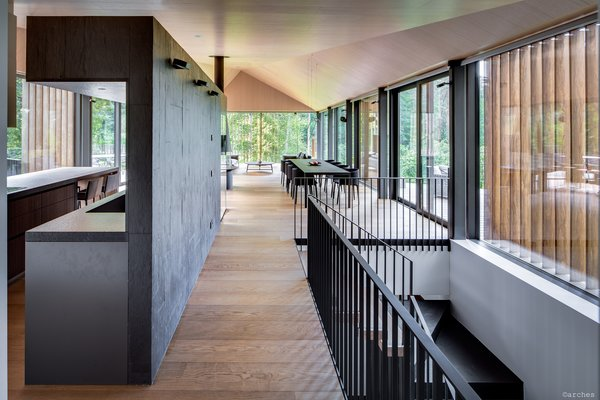 Screens composed of vertical wood slats discourage interior overheating and are a decorative feature.