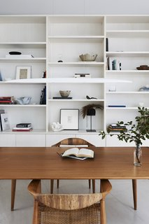 The home office displays the owner's art collection, including ceramic vases by unit89.