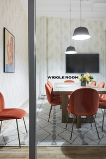 The conference room is dubbed the Wiggle Room for the extra space it provides the team, as opposed to their previous quarters.