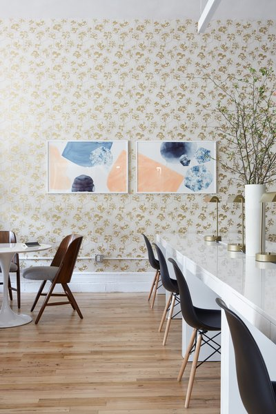 Art by Lindsay Gardner adorns the Farrow and Ball wallpaper.