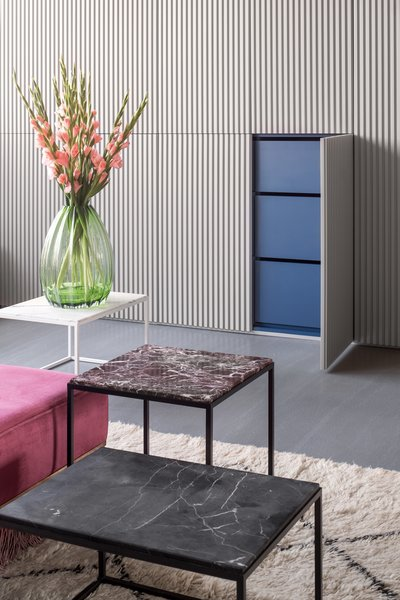 """""""The design plays off one's expectations of insides and outsides: open the cool gray wardrobe doors and be surprised by bright blue,"""" says the firm."""