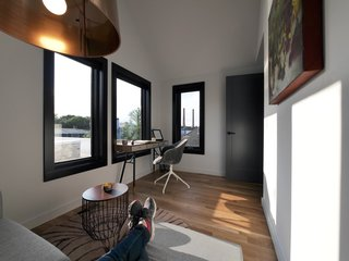 The office has a smaller footprint than the bedrooms, but windows capture city views.