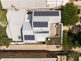 A view of the solar panels and extra gardening space on the green roof.
