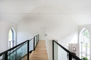 The upper walkway leads to the master bedroom suite.
