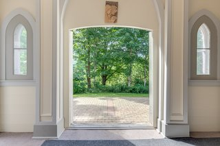 The layout of the entrance was maintained, including the lancet-style windows that flank the front doors, but this door now accesses the backyard.