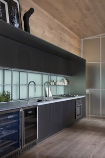 The charcoal kitchen cabinets are from Dell Anno.