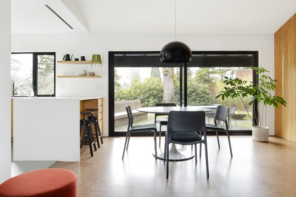 """Fieldwork replaced the previous doors a large, two-panel slider. The cork flooring was laid in place of parquet, as it is """"true to the era of the home but gave it a more contemporary feel,"""" says Wise."""
