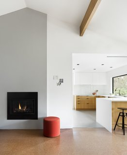 The fireplace was streamlined with plaster and a gas insert.