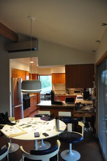 Before: the existing kitchen cabinets were not up to the task of corralling the family's belongings.