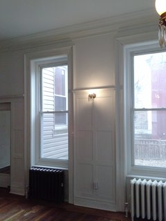 Before: These windows in the previous formal dining room were modified to create access to the backyard.