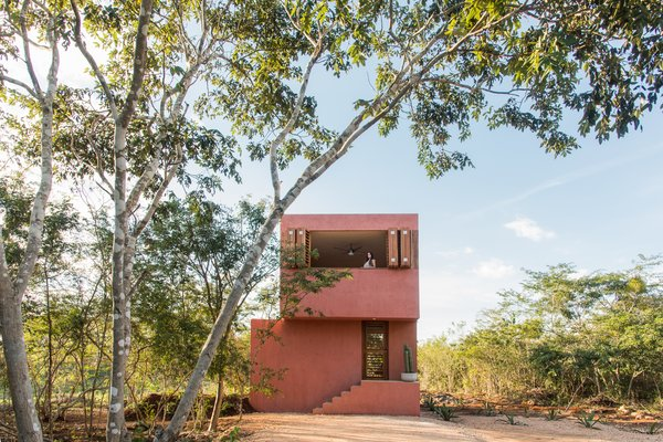 """In order to create a small yet comfortable vacation home for a young couple, the multidisciplinary workshop TACO, or Taller de Arquitectura Contextual, sited it in the corner of a two-acre lot, then employed built-in elements for an """"intuitive"""" interior layout."""