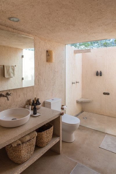 The upper floor has a smaller footprint than the lower floor. This created an opportunity to remove the ceiling in the shower to let the owners bathe outdoors in privacy.