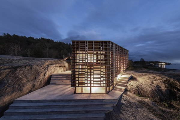 At night, the exterior screen provides privacy when the house is illuminated.