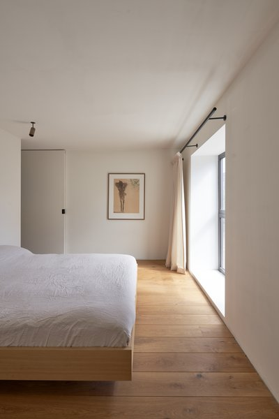 Oiled oak floors in the master suite provide continuity with the joinery downstairs.