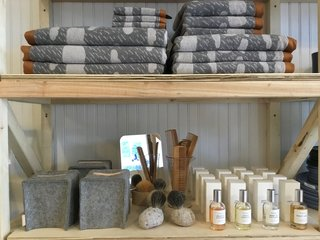 Toiletries and bath supplies include the Rainy Day towel collection by Donna Wilson, wool and leather tissue box covers by Graf Lantz, and West Third Brand perfumes.