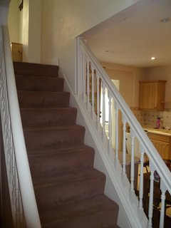Another goal of the renovation was to improve access between floors beyond this narrow, enclosed staircase.